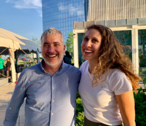 Dr. David Wolk and Grace Stockbower smiling together in an outdoor setting.